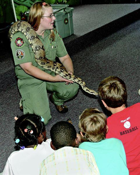 Birthday party showing kids Boa Constrictor